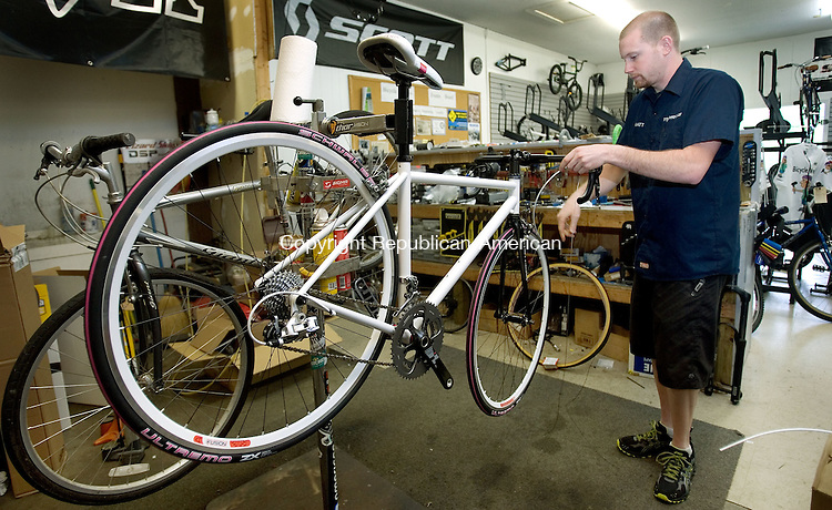 MIDDLEBURY, CT. 14 May 2012-051412SV07-Matt Morris, of Bicycle Works, assembles a charity bike to be auctioned off by Are You Dense, Inc. later this year for breast cancer research in Middlebury Monday..Steven Valenti Republican-American