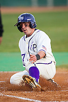 Dane McDermott (7) of the High Point Panthers slides across home plate to score a run against the catcher at Willard Stadium on March 15, 2014 in High Point, North Carolina.  (Brian Westerholt/Four Seam Images)