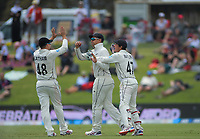 NZ's Tom Latham (left) and BJ Watling congratulate Ross Taylor for catching England's Ben Stokes during day two of the international cricket 1st test match between NZ Black Caps and England at Bay Oval in Mount Maunganui, New Zealand on Friday, 22 November 2019. Photo: Dave Lintott / lintottphoto.co.nz