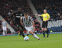 Paul McGowan gets away from Victor Wanyama but is offside in the St Mirren v Celtic Scottish Communities League Cup Semi Final match played at Hampden Park, Glasgow on 27.1.13.