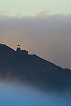 Point Sur Lighthouse and morning fog at sunrise, Big Sur, Monterey County coast, California