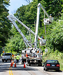 TORRINGTON CT. - 08 August 2020-080820SV01-Electrical crews working with Eversource hang power lines in the area of 1170 Goshen Road in Torrington Saturday.<br /> Steven Valenti Republican-American