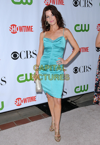 LAURA LEIGHTON.The CBS, CW & Showtime TCA Party held at The Huntington Library in San Marino, California, USA. .August 3rd, 2009                                                                   full length green teal dress ruched gold sandals hand on hip silver clutch bag .CAP/RKE/DVS.©DVS/RockinExposures/Capital Pictures.