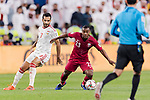 Assim Madibo of Qatar (C) fights for the ball with Ali Ahmed Mabkhout of United Arab Emirates (L) during the AFC Asian Cup UAE 2019 Semi Finals match between Qatar (QAT) and United Arab Emirates (UAE) at Mohammed Bin Zaied Stadium  on 29 January 2019 in Abu Dhabi, United Arab Emirates. Photo by Marcio Rodrigo Machado / Power Sport Images