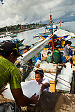 PHILIPPINES, Palawan, Puerto Princesa, Handline fishermen in the City Port Area load a boat called Kivea with ice and prepare for a week long trip