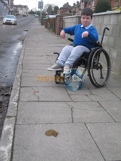 Zane O Hoistin who struggles to get from his home to school on the footpaths when dog owners fail to clean up after there animals.<br /> Picture: Fran Caffrey www.newsfile.ie