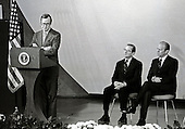 George H.W. Bush, new Director, Central Intelligence Agency (CIA), left, makes remarks after taking his oath of office as United States President Gerald R. Ford, right, and former CIA Director William Colby, center, look on at the agency's headquarters in Langley, Virginia on January 30, 1976.  <br /> Credit: Barry Soorenko / CNP