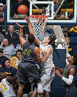 David Kravish of California blocks the ball during the game against UC Irvine at Haas Pavilion in Berkeley, California on December 2nd, 2013.  California defeated UC Irvine, 73-56.