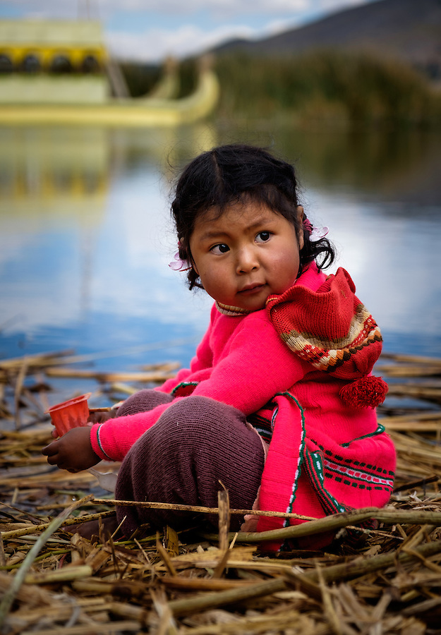 UROS ISLANDS, PERU - CIRCA October 2015: Girl from the Uros Islands in Lake Titicaca.