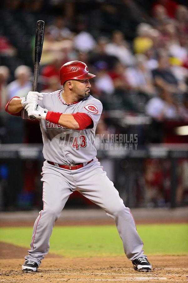 Aug. 29, 2012; Phoenix, AZ, USA: Cincinnati Reds first baseman Miguel Cairo against the Arizona Diamondbacks at Chase Field. Mandatory Credit: Mark J. Rebilas-USA TODAY Sports