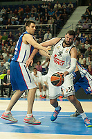 Real Madrid´s Ioannis Bourousis and Anadolu Efes´s Milko Bjelica during 2014-15 Euroleague Basketball match between Real Madrid and Anadolu Efes at Palacio de los Deportes stadium in Madrid, Spain. December 18, 2014. (ALTERPHOTOS/Luis Fernandez) /NortePhoto /NortePhoto.com