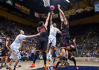 California's Tyrone Wallace shoots for the basket during game against USC at Haas Pavilion in Berkeley, California on February 23th, 2014. California defeated USC 77 - 64