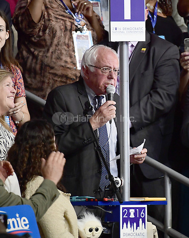 United States Senator Bernie Sanders (Democrat of Vermont) moves that the rules of the convention be suspended and Hillary Clinton be nominated by acclamation during the second session of the 2016 Democratic National Convention at the Wells Fargo Center in Philadelphia, Pennsylvania on Tuesday, July 26, 2016.  His wife Jane Sanders looks on from left.<br /> Credit: Ron Sachs / CNP/MediaPunch<br /> (RESTRICTION: NO New York or New Jersey Newspapers or newspapers within a 75 mile radius of New York City)