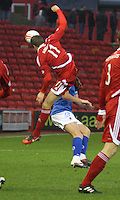 Kari Arnason goes in high on Stephen McKenna in the Aberdeen v Queen of the South William Hill Scottish Cup 5th Round match played at Pittodrie Stadium, Aberdeen on 4.2.12.