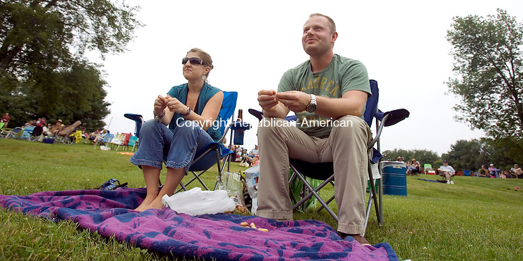 (Countrylife Use Only)<br /> ROXBURY CT. 13 July 2013-071313SV10-Caitlin and Tim Lewis of New Milford enjoy the 39th annual Pickin ' &amp; Fiddlin ' Contest in Roxbury Saturday.<br /> Steven Valenti Republican-American