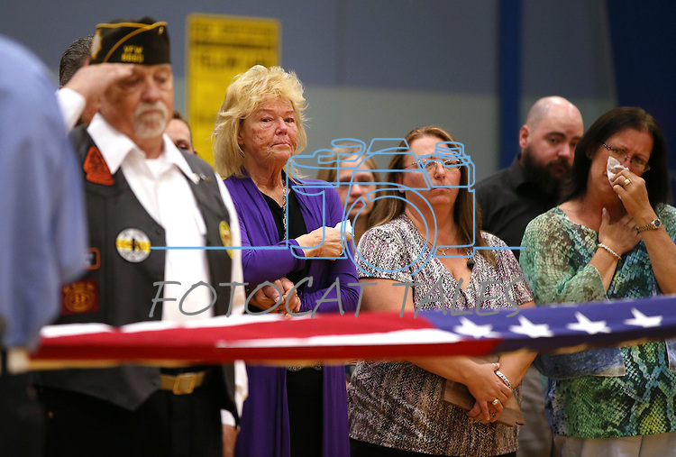 Peggy Eddington-Smith, Donna Gregory and her sister Brenda Allen watch a ceremony, in Dayton, Nev., on Saturday, Sept. 20, 2013. After Gregory's 14 years of searching for relatives of World War II Private John F. Eddington, the medal and other personal items, found in Missouri, were returned to Eddington-Smith. <br /> Photo by Cathleen Allison/Las Vegas Review-Journal