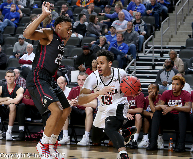 SIOUX FALLS, SD: MARCH 6: Daniel Norl #13 from Omaha looks to make a move past Ron Patterson #25 from IUPUI during the Summit League Basketball Championship on March 6, 2017 at the Denny Sanford Premier Center in Sioux Falls, SD. (Photo by Dave Eggen/Inertia)