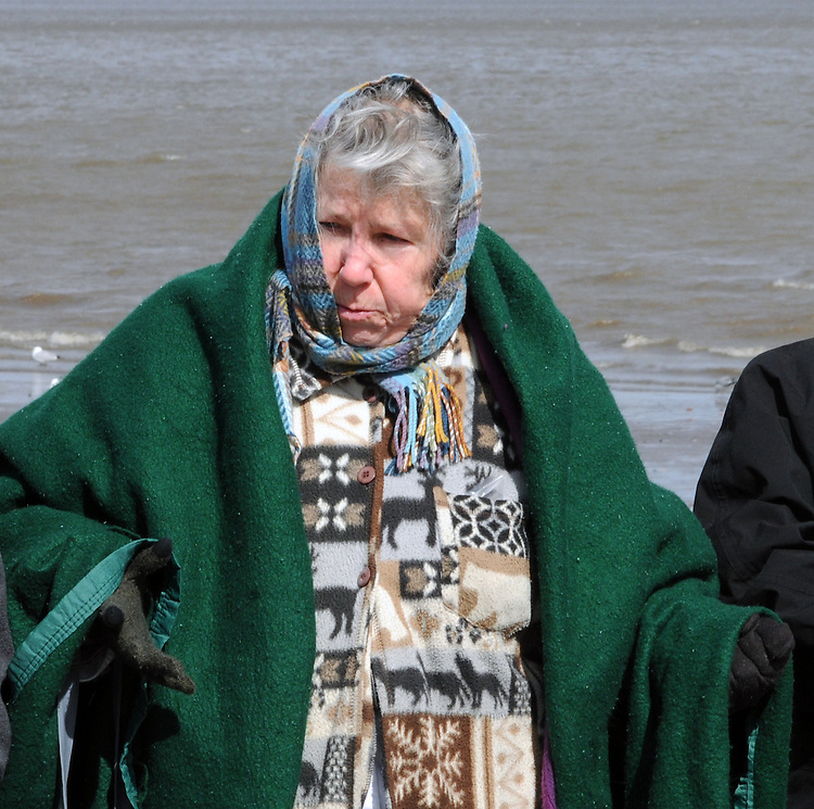 Etaoqua (Mahicanu), wearing green shawl, representing the Assn of Native American of the Hudson Valley, seen leading a Native American Water Blessing Ceremony held for the Hudson River at Kingston Point Beach in Kingston, NY, on Saturday, March 4, 2017. Photo by Jim Peppler; Copyright Jim Peppler 2017