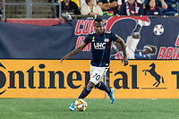 FOXBOROUGH, MA - AUGUST 31: Cristian Penilla #70 of New England Revolution looks to pass during a game between Toronto FC and New England Revolution at Gillette Stadium on August 31, 2019 in Foxborough, Massachusetts.