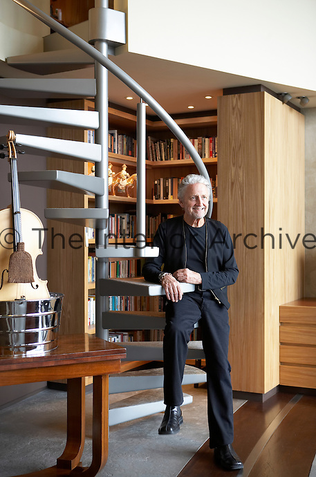 Designer Ron Mann seen in his modern penthouse apartment in London