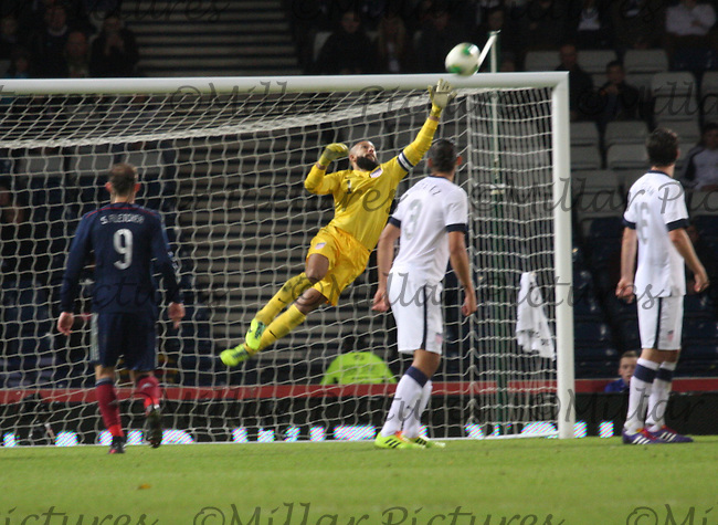 Tim Howard saves a free kick in the Scotland v USA friendly International match at Hampden Park, Glasgow on 15.11.13.