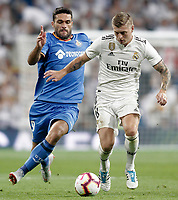 Real Madrid's Toni Kroos (r) and Getafe CF's Jorge Molina during La Liga match. August 19,2018.  *** Local Caption *** &copy; pixathlon<br /> Contact: +49-40-22 63 02 60 , info@pixathlon.de