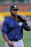 Outfielder Ivan Wilson (18) of the Columbia Fireflies warms up before a game against the Greenville Drive on Thursday, April 21, 2016, at Fluor Field at the West End in Greenville, South Carolina. Columbia won, 13-9. (Tom Priddy/Four Seam Images)