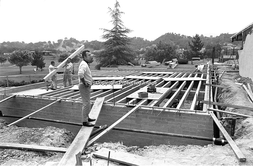 Golf Pro. Tom O'Leary watching the construction around the club house at Round Hill CC.<br />(1969 photo/Ron Riesterer)