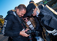 Getty Images photographer Phil Walter shows fans his photo fo them as supporters make their way to the Rugby Championship match between the New Zealand All Blacks and Argentina Pumas at Trafalgar Park in Nelson, New Zealand on Saturday, 8 September 2018. Photo: Dave Lintott / lintottphoto.co.nz