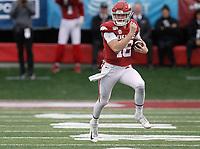Arkansas Democrat-Gazette/THOMAS METTHE -- 11/29/2019 --<br /> Arkansas quarterback Jack Lindsey (18) runs the ball during the second quarter of the Razorbacks' 24-14 loss to Missouri on Friday, Nov. 29, 2019, at War Memorial Stadium in Little Rock.