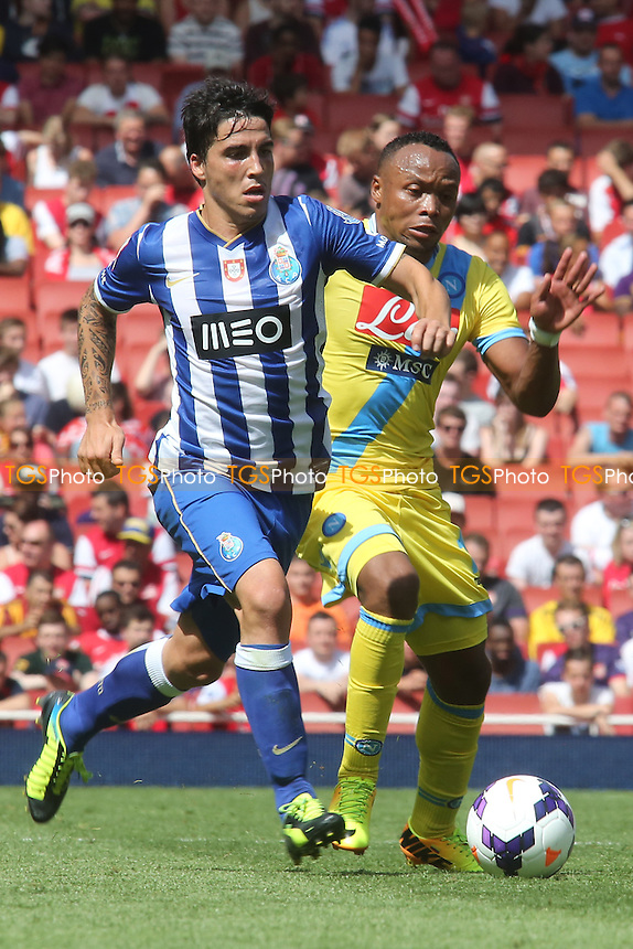 Josue of FC Porto takes the ball past Napoli's Juan Zuniga - Napoli vs FC Porto - Emirates Cup Football at The Emirates Stadium, London - 04/08/13 - MANDATORY CREDIT: Paul Dennis/TGSPHOTO - Self billing applies where appropriate - 0845 094 6026 - contact@tgsphoto.co.uk - NO UNPAID USE