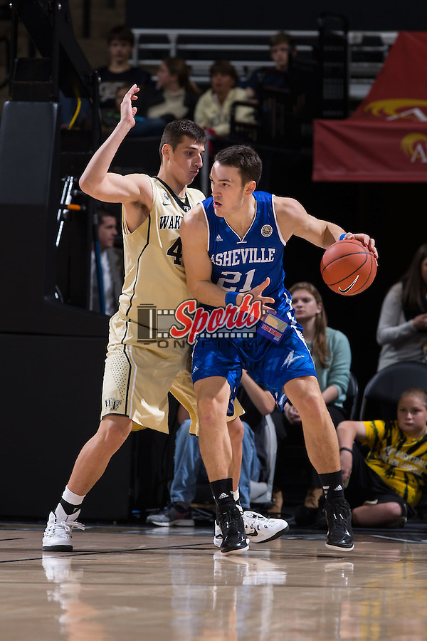 Giacomo Zilli (21) of the UNC Asheville Bulldogs tries to back down Dinos Mitoglou (44) of the Wake Forest Demon Deacons during first half action at the LJVM Coliseum on November 14, 2014 in Winston-Salem, North Carolina.  The Demon Deacons defeated the Bulldogs 80-69  (Brian Westerholt/Sports On Film)