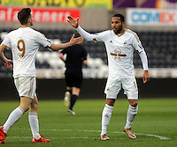 Pictured: Kenji Gorre of Swansea (R) celebrates with team mate Alex Bray (L) after scoring his equaliser Monday 25 April 2016<br />