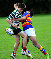 Action from the Hurricanes under-15 rugby tournament match between Westlake Boys' High School (white and green hoops) and Tawa College (red gold and blue hoops) at Trentham Memorial Park in Upper Hutt, Wellington, New Zealand on Thursday, 7 September 2017. Photo: Dave Lintott / lintottphoto.co.nz