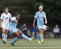 University of North Carolina midfielder Crystal Dunn (19) passes the ball.   University of North Carolina (blue) defeated Boston College (white), 1-0, at Newton Campus Field, on October 13, 2013.