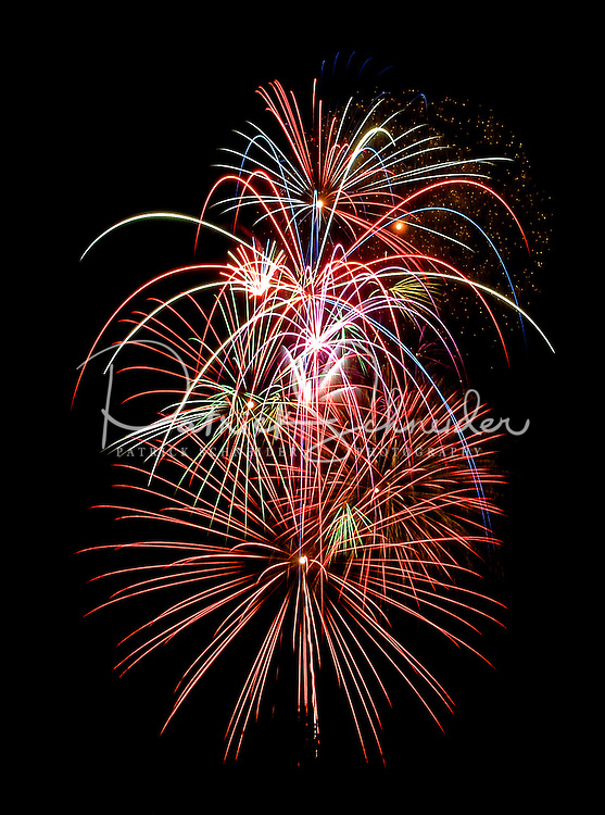 Fireworks shoot into the night sky as part of an annual Fourth of July Celebration near Birkdale Village in Huntersville, NC. Birkdale Village combines the best of shopping, dining, apartments and entertainment venues within a 52-acre mixed-use development.