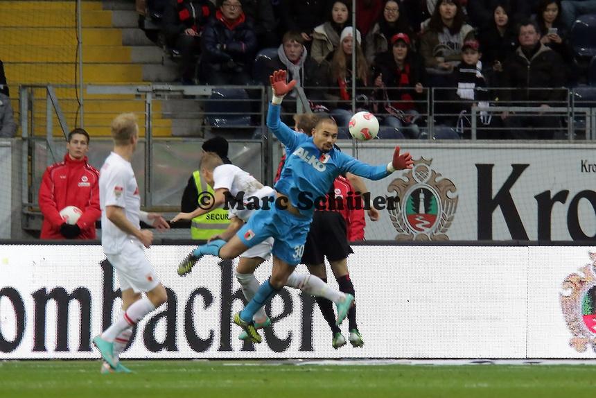 Mohamad Amsif (Augsburg) faengt den Ball und wird von Matthias Ostrzolek (Augsburg) behindert