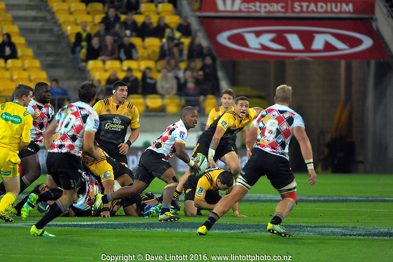 Kings halfback Ntando Kebe looks to pass from a ruck during the Super Rugby match between the Hurricanes and Southern Kings at Westpac Stadium, Wellington, New Zealand on Friday, 25 March 2016. Photo: Dave Lintott / lintottphoto.co.nz