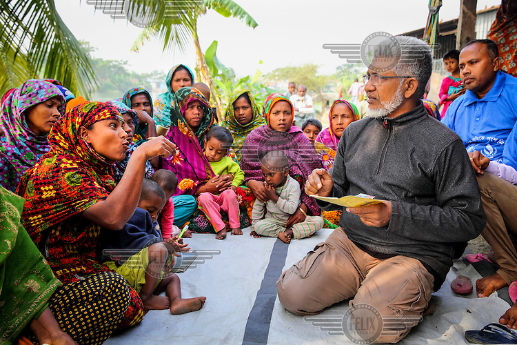 Rafiqul Alam, an anti-povery activist who runs the NGO Dwip Unnayan Songstha (DUS), meets with women living on a newly formed island of Kolatoli. They lost their own land and homes to erosion and are seaking help from DUS after moving to the new island.