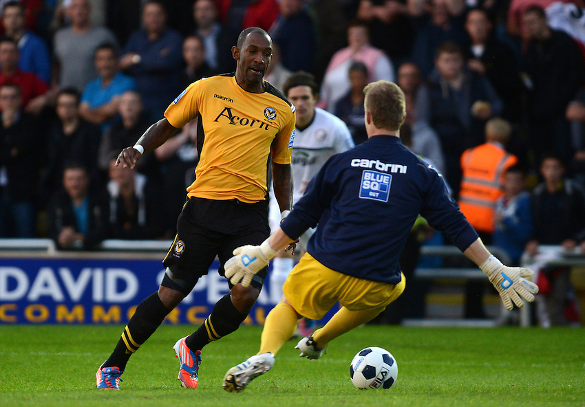 Newport County's Jefferson Louis tries to get round Hereford United's Dan Hanford..Newport County V Hereford United - Blue square Premier division - Tuesday 28th August 2012 - Football  - Rodney Parade - Newport..