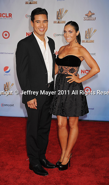 SANTA MONICA, CA - SEPTEMBER 10: Mario Lopez and Courtney Mazza. attend the 2011 NCR ALMA Awards at Santa Monica Civic Auditorium on September 10, 2011 in Santa Monica, California.
