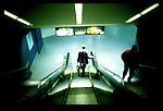 Man descends escalator, New York...New York City, New York.  Street Photography from Manhattan and Brooklyn.  Subway, Union Square, Metro Stations, New York City Skyline, Michael Rubenstein, Matt Nager, Jacob Pritchard.