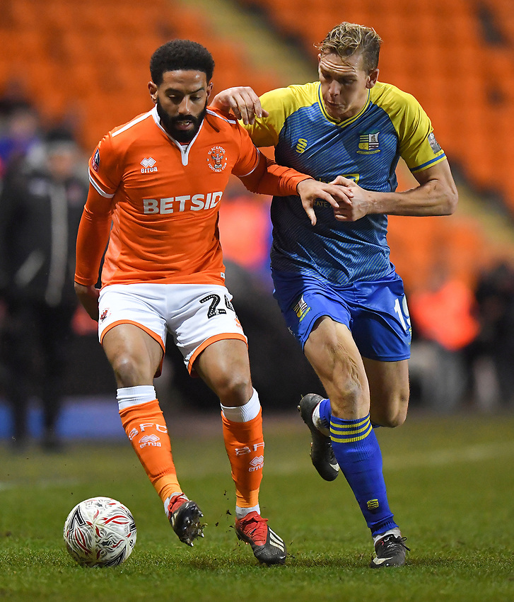 Blackpool's Liam Feeney battles with Solihull Moors' Danny Wright<br /> <br /> Photographer Dave Howarth/CameraSport<br /> <br /> The Emirates FA Cup Second Round Replay - Blackpool v Solihull Moors - Tuesday 18th December 2018 - Bloomfield Road - Blackpool<br />  <br /> World Copyright © 2018 CameraSport. All rights reserved. 43 Linden Ave. Countesthorpe. Leicester. England. LE8 5PG - Tel: +44 (0) 116 277 4147 - admin@camerasport.com - www.camerasport.com