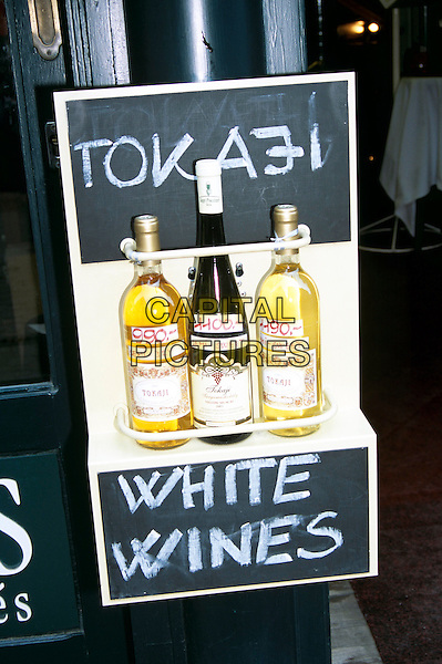 Three bottles of white wine on display outside wine shop, Castle Hill area, Budapest, Hungary