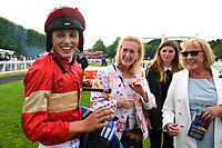 Jockey George Wood shares a joke with connections of Exceeding Power in the winners enclosure during Ladies Evening Racing at Salisbury Racecourse on 15th July 2017