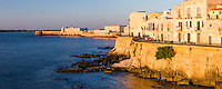 Panoramic photo of Ortigia at sunrise, with Ortigia Castle (Castello Maniace, Castle Maniace) in the background, Syracuse (Siracusa), UNESCO World Heritage Site, Sicily, Italy, Europe. This is a panoramic photo of Ortigia at sunrise, with Ortigia Castle (Castello Maniace, Castle Maniace) in the background, Syracuse (Siracusa), UNESCO World Heritage Site, Sicily, Italy, Europe.