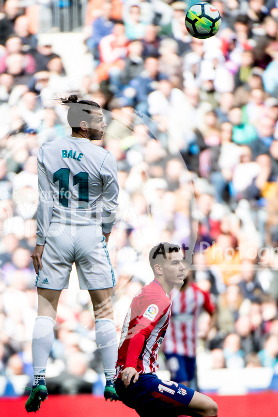 Real Madrid's Welsh forward Gareth Bale; Atletico Madrid's French defender Lucas Hernadez<br /> Spanish league football match Real Madrid vs Atletico de Madrid at the Santiago Bernabeu stadium in Madrid on April 8, 2018.