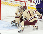 Thatcher Demko (BC - 30), Isaac MacLeod (BC - 7) - The visiting College of the Holy Cross Crusaders defeated the Boston College Eagles 5-4 on Friday, November 29, 2013, at Kelley Rink in Conte Forum in Chestnut Hill, Massachusetts.