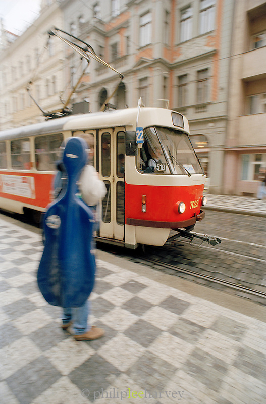 Person waiting for a tram in Prague, Czech Republic