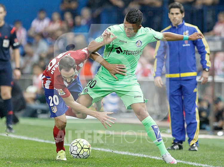 Atletico de Madrid's Juanfran Torres (l) and Getafe's Wanderson during La Liga match.September 22,2015. (ALTERPHOTOS/Acero)